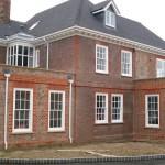 Period sash windows with matching bifold doors