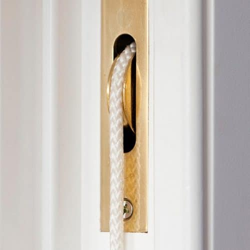 Sash window brass pulleys