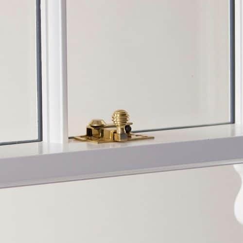 Sash window brass fasteners