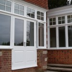 French doors with panels and side wings