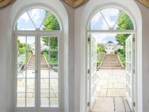Traditional Georgian style French doors with fanlights