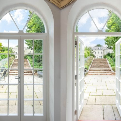 Georgian style French doors with fanlights