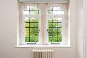 Leaded timber 'bottle top' casement windows