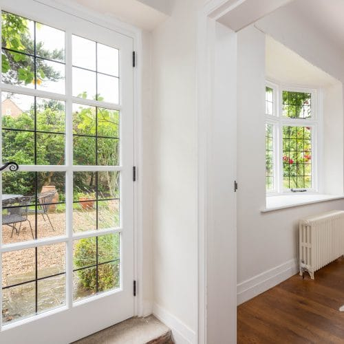 Timber casement bay window and leaded timber door