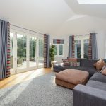 Matching bifold and French doors with glazing bars