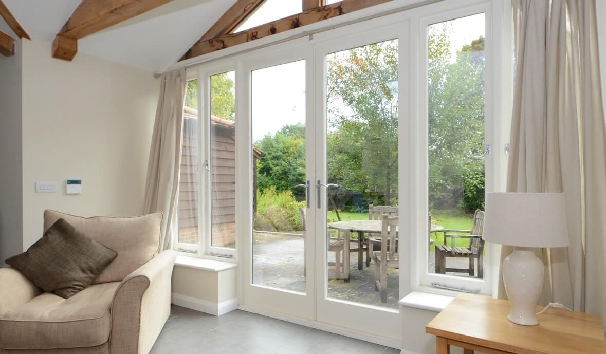 Timber French doors with side panels