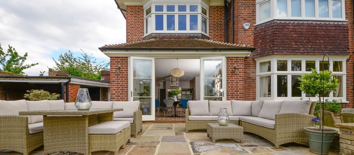 French doors with matching casement windows on period property in Surrey