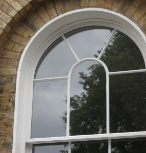 Curved sash window on grade II listed building
