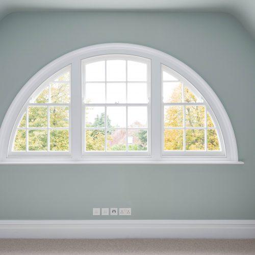 Close up curved sash windows with glazing bars