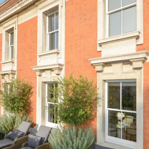 Double glazed sash windows on conservation property