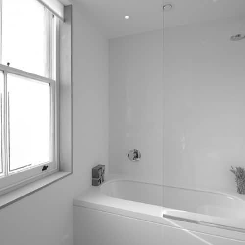 Sash window with opaque glass in bathroom